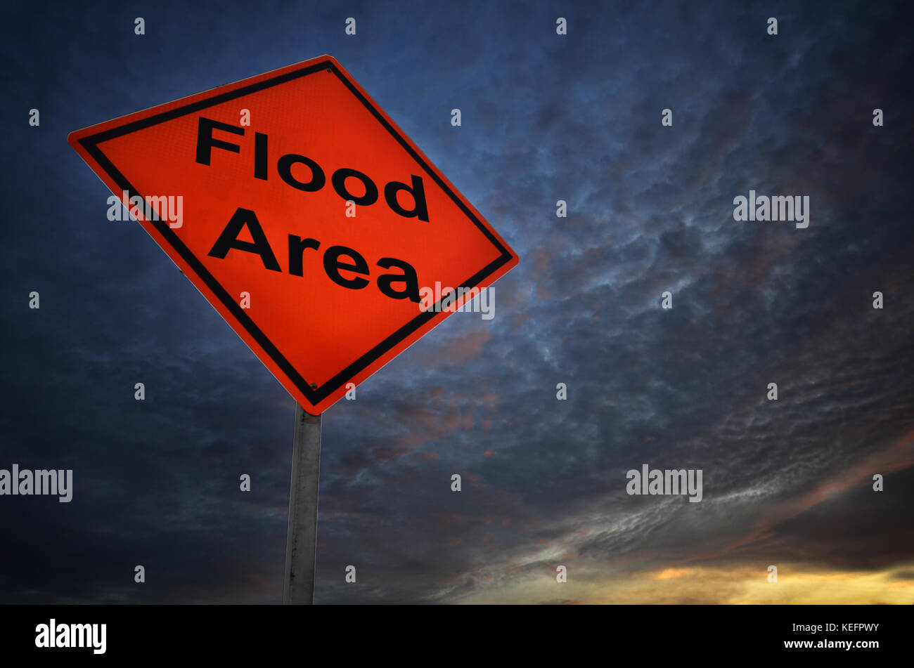 Flood Area warning road sign with storm background Stock Photo