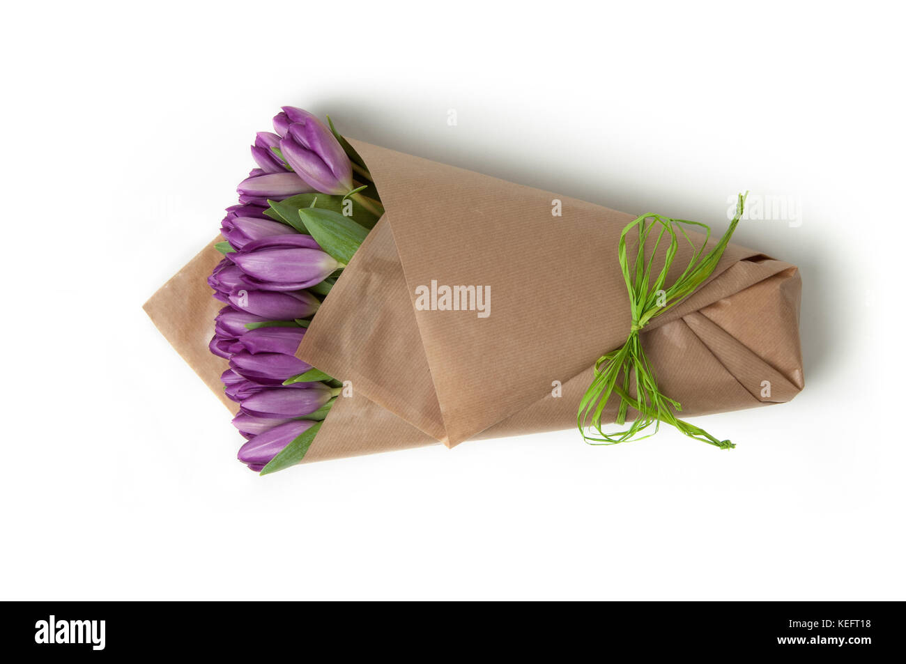 violet tulips in a paper bouquet associated ribbon. Valentine's Day - Stock Image