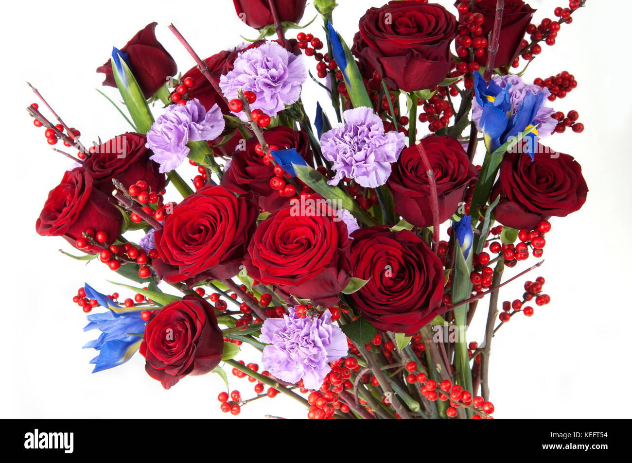 A bouquet of red roses and assorted flowers on white background a bouquet of red roses and assorted flowers on white background close up valentines day izmirmasajfo