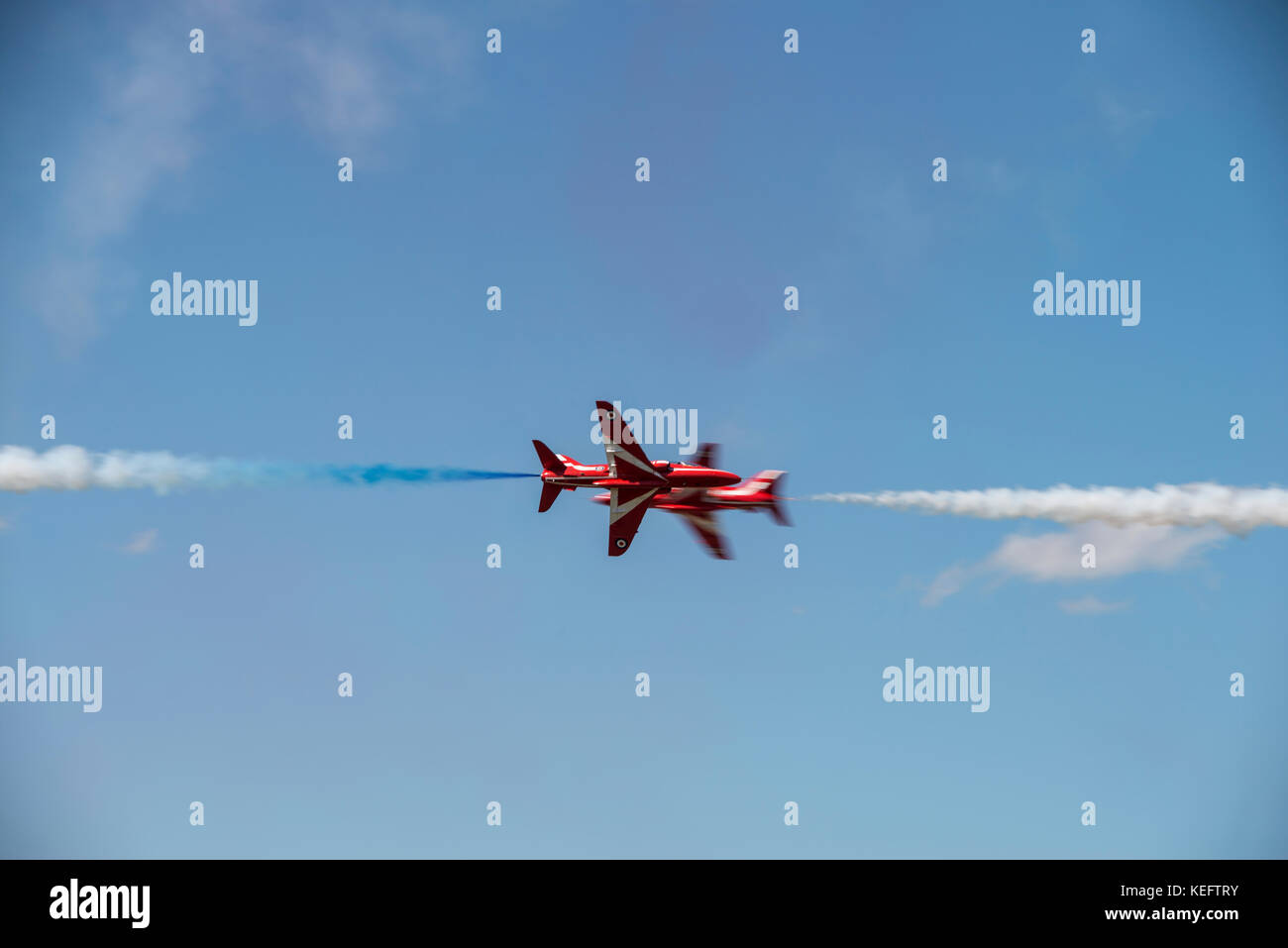 Red Arrows aerobatic opposition crossover - Stock Image