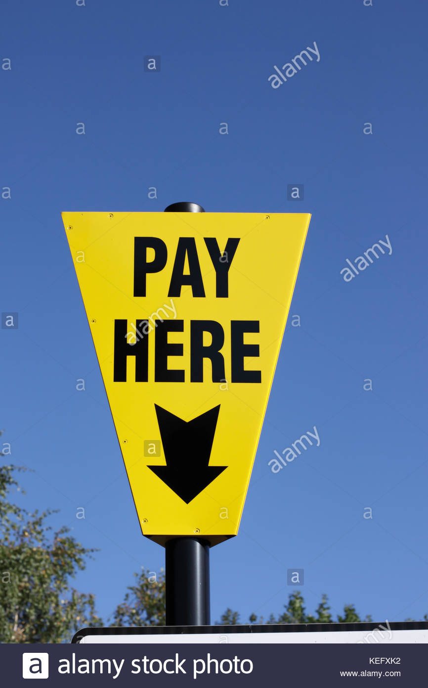 Car Park Pay Here Sign Indicating Location Of Ticket Machine, UK - Stock Image