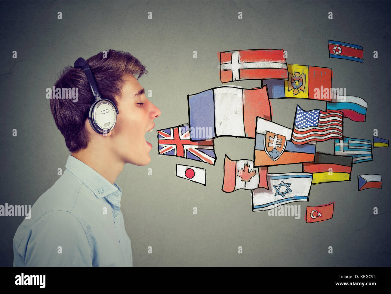 Young man learning different languages - Stock Image