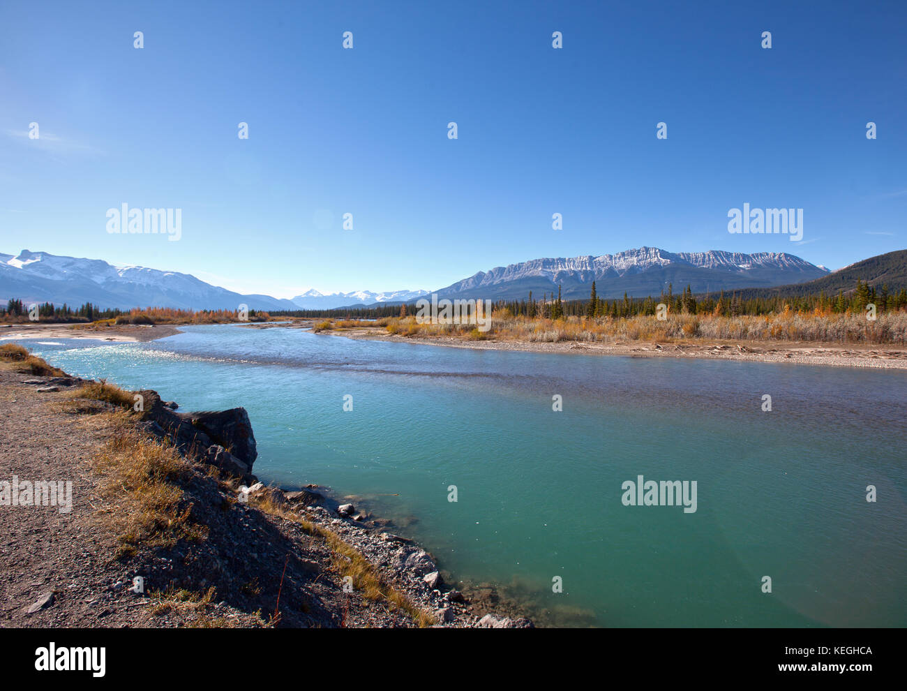 a popular tourist lookoff spot by the Athabasca River in Jasper Park, Alberta with rocky mountain view - Stock Image