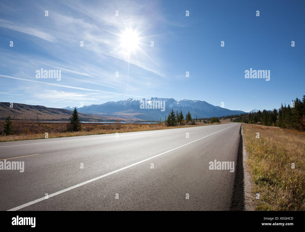 an empty stretch of the canadian highway through the rocky mountains in Jasper, Alberta - Stock Image