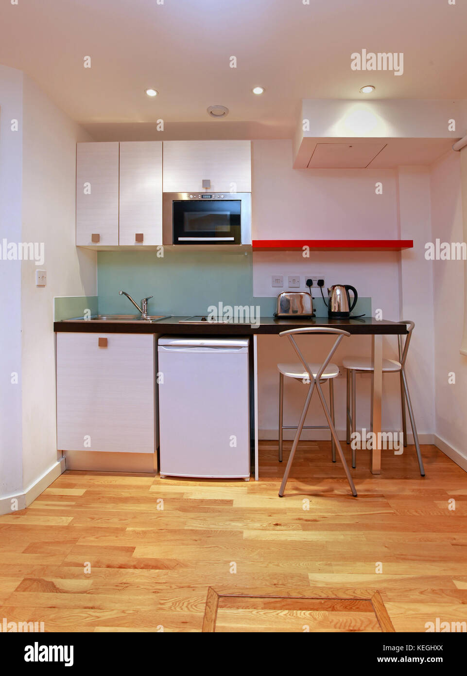 Small Modern Kitchen In Tiny Studio Apartment Stock Photo Alamy