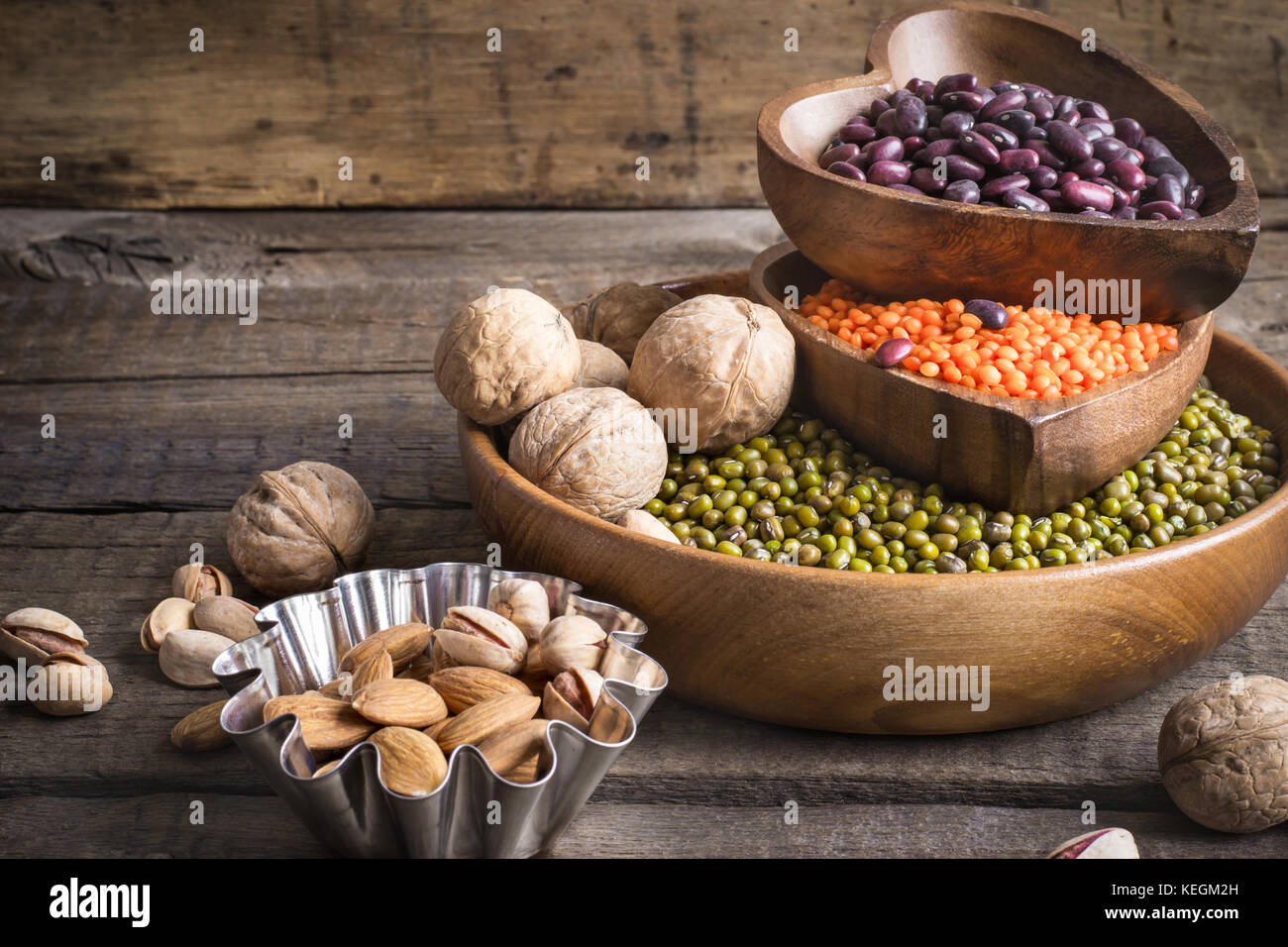 Sources of vegetable protein are various legumes and nuts. - Stock Image