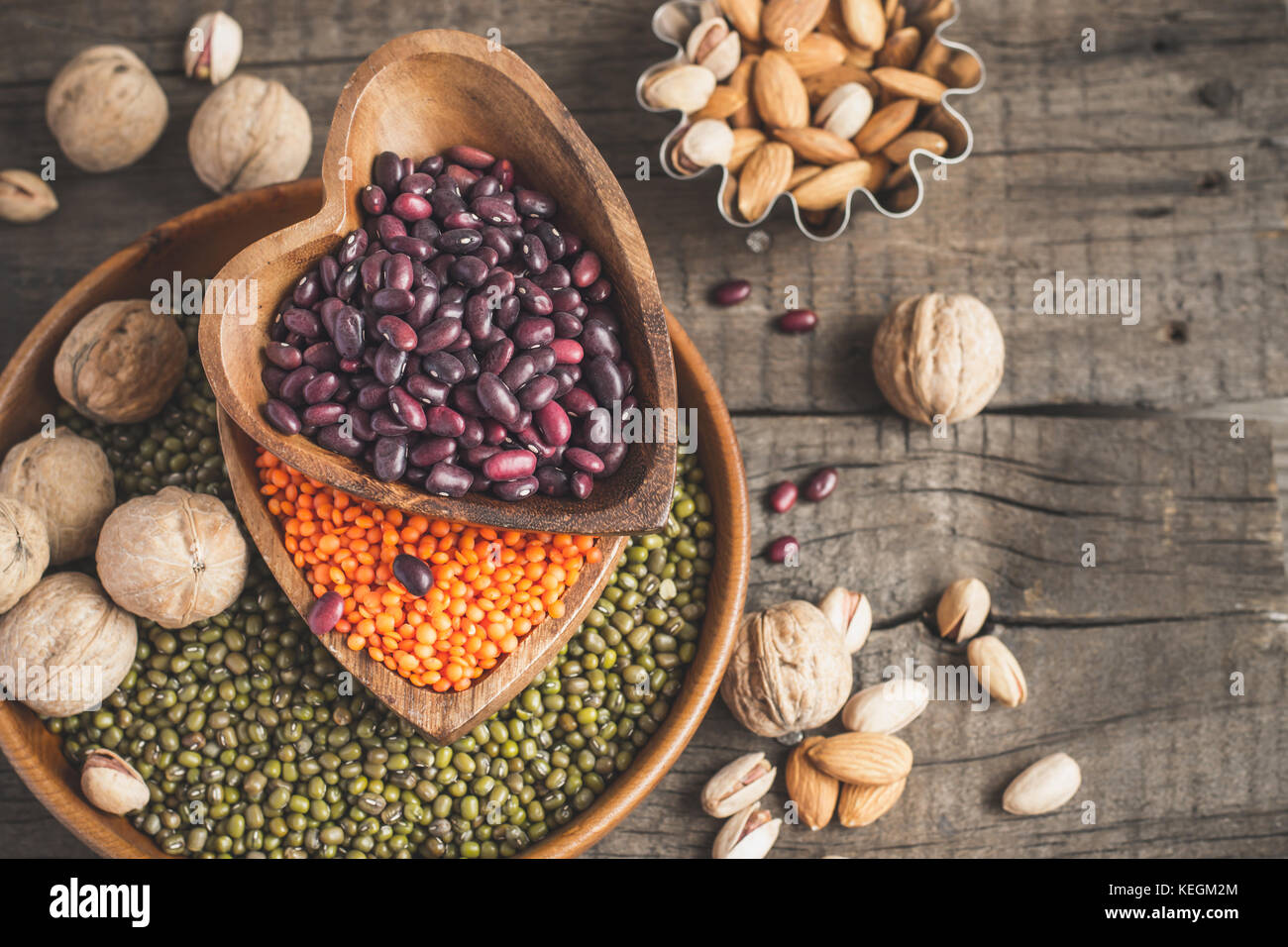 Sources of vegetable protein are various legumes and nuts. Top view with copy space. - Stock Image