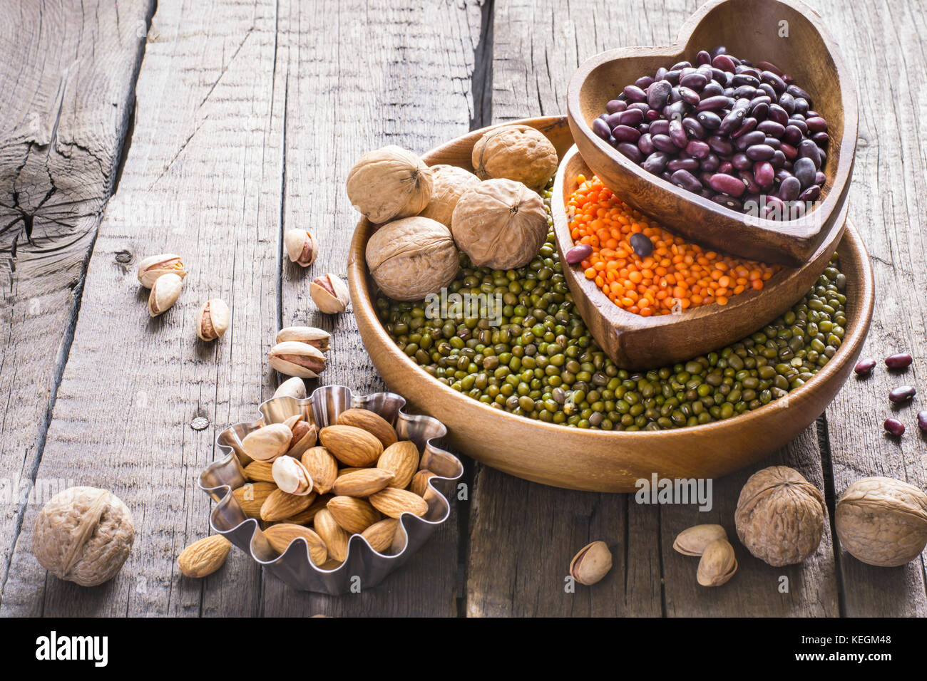 Sources of vegetable protein. collection of various legumes and nuts - Stock Image