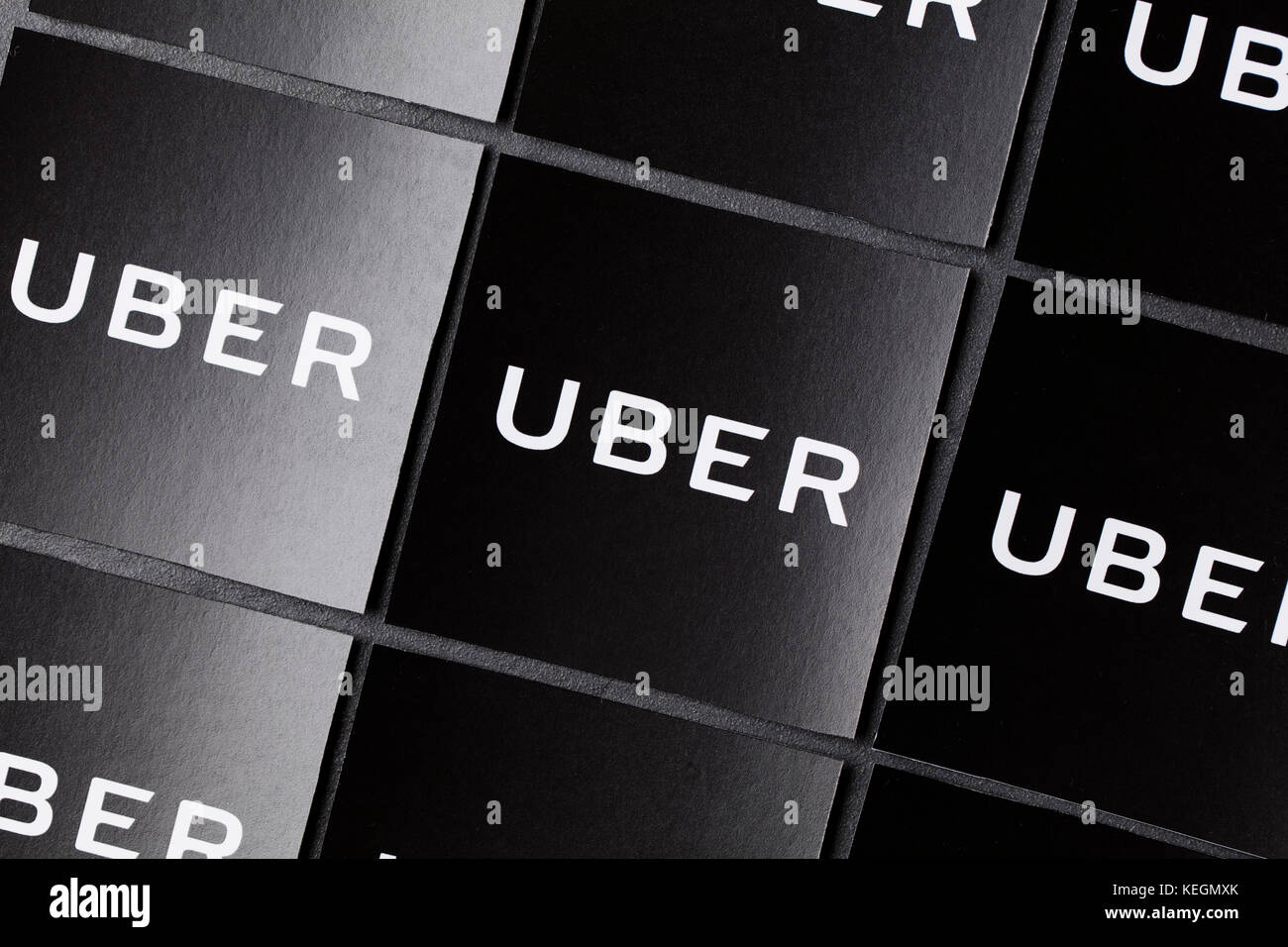 A photograph of  the Uber logo. Uber is a popular taxi style transport service application, founded in 2009 - Stock Image
