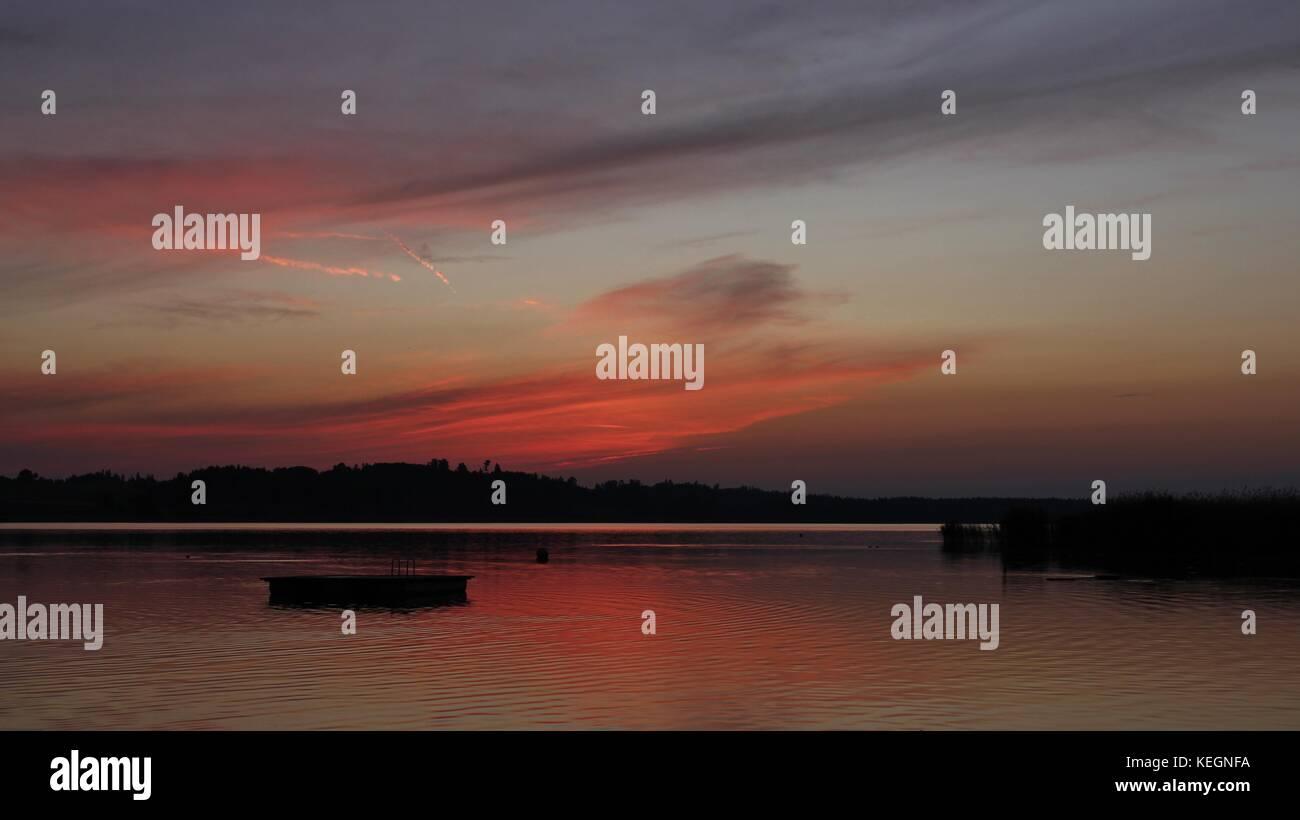Summer evening at lake Pfaeffikon, Zurich Canton. Colorful sunset. - Stock Image