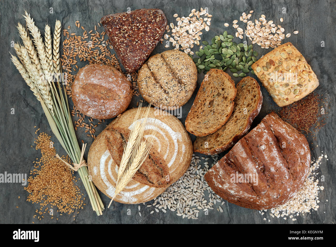 High dietary fibre health food concept with multi seed whole grain rolls, seeds, nuts and cereals. Foods high in - Stock Image