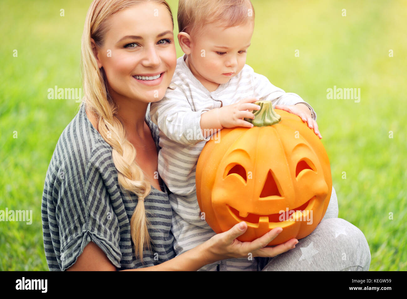 Closeup portrait of a beautiful young mother with her precious little son preparing to his first Halloween holiday, - Stock Image