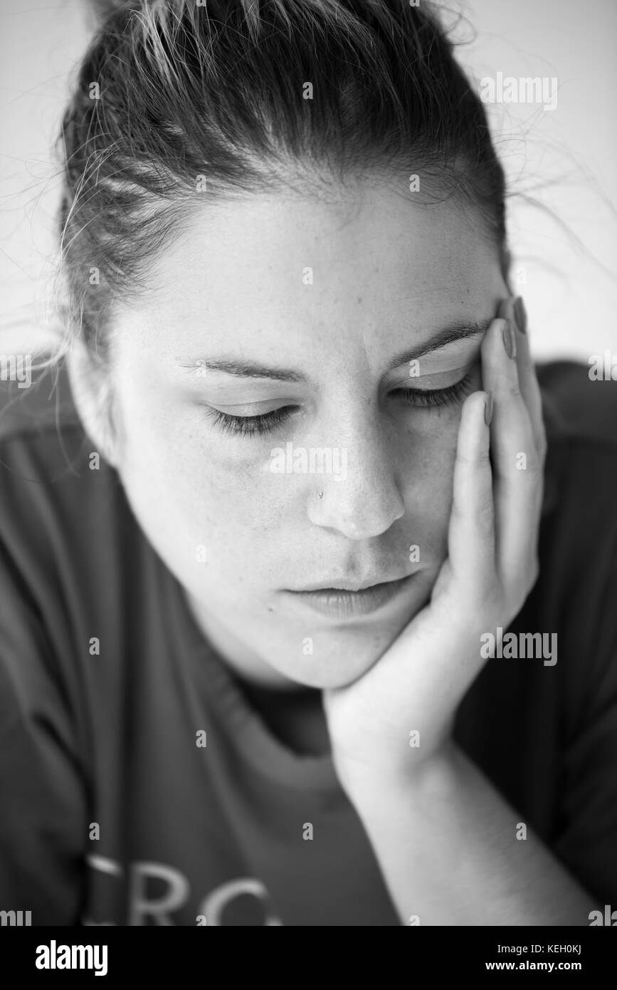 Black and White woman portrait with hand on her face - Stock Image