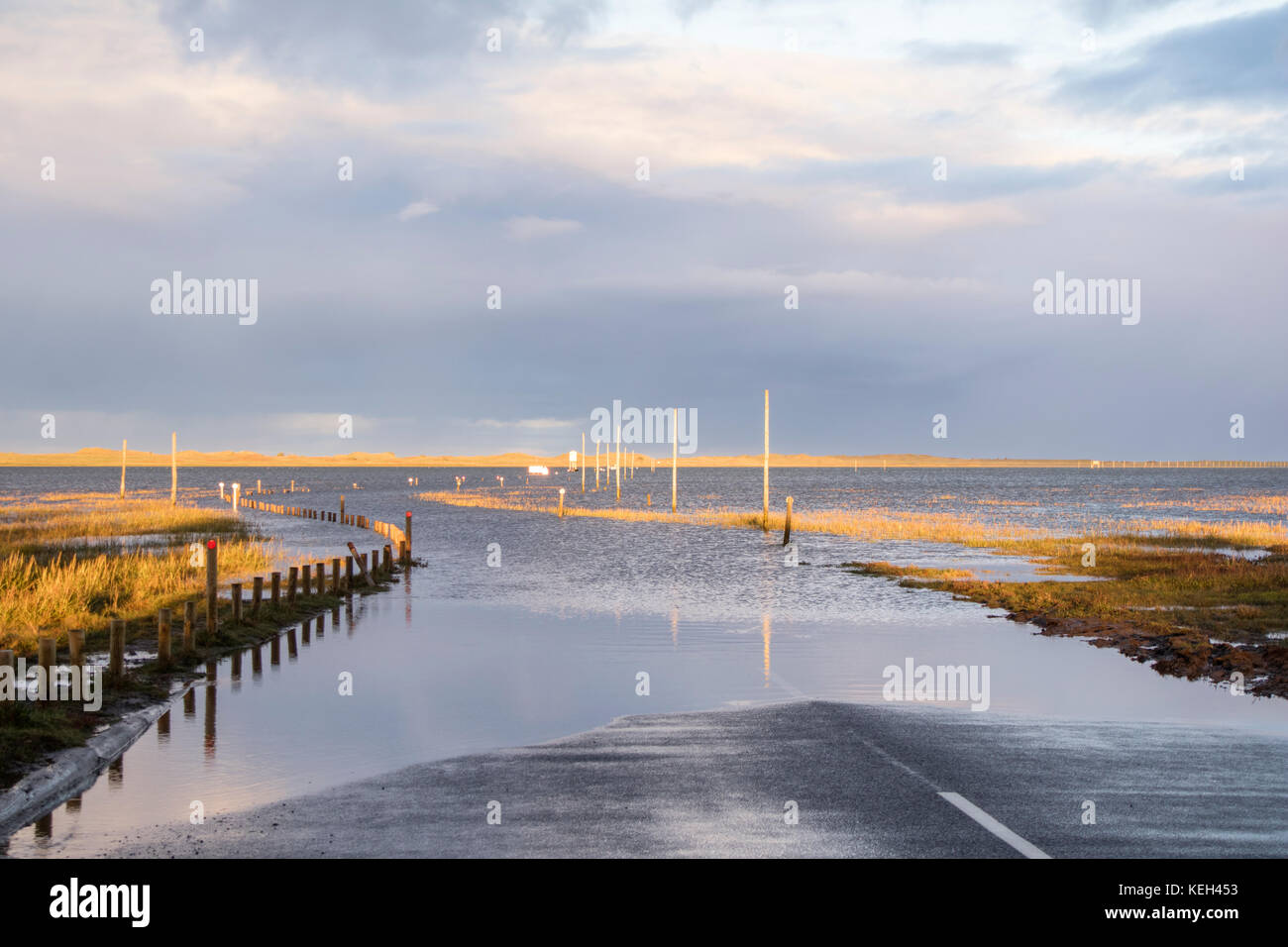 Late afternoon light over Lindisfarne or Holy Island tidal causeway at high tide looking towards Lindisfarne, Northumberland, England, UK Stock Photo