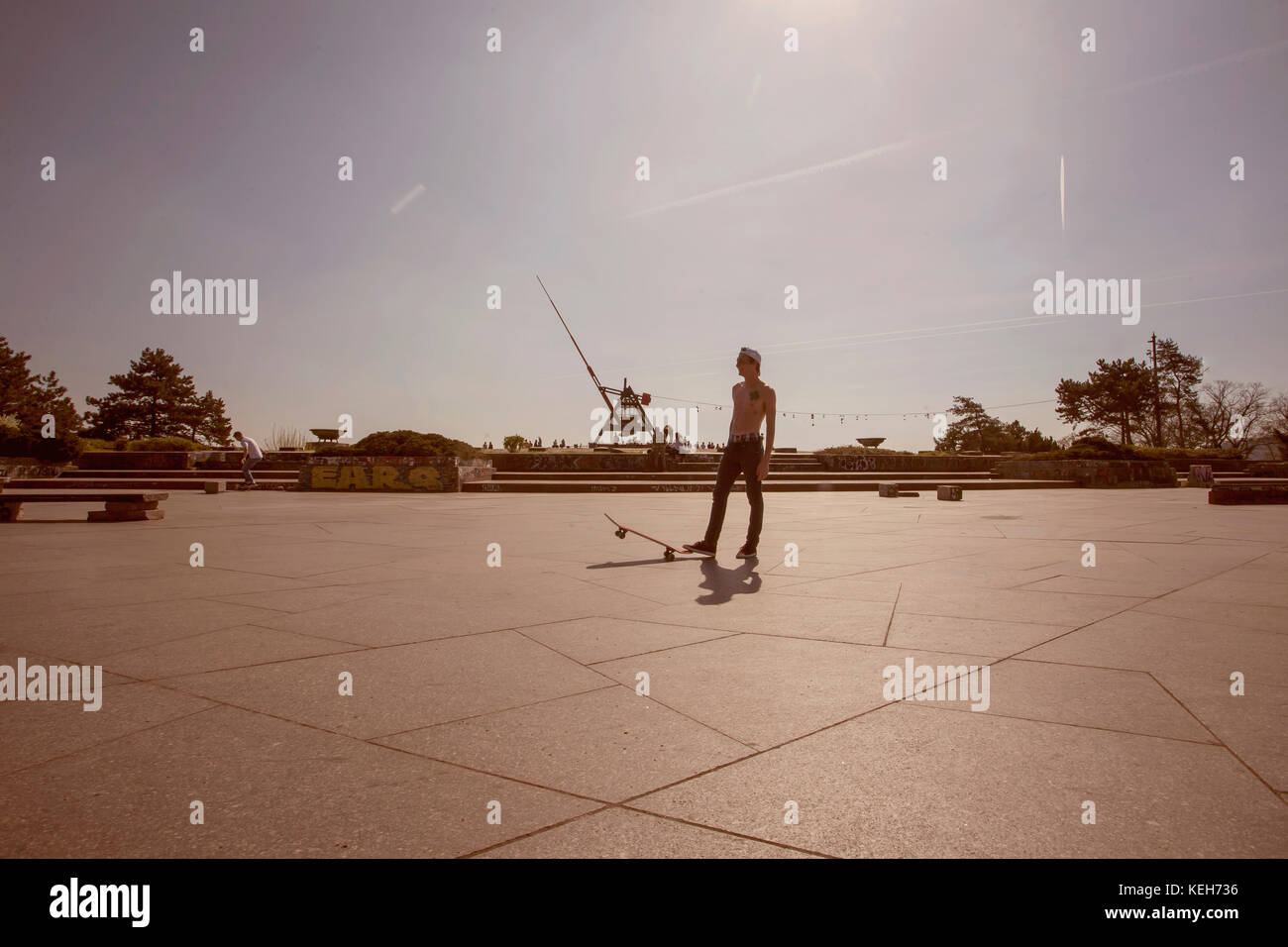 Prague metronom view with skateboarding young man at Letna district, March 2017, Prague, Czech Republic, Illustrative - Stock Image