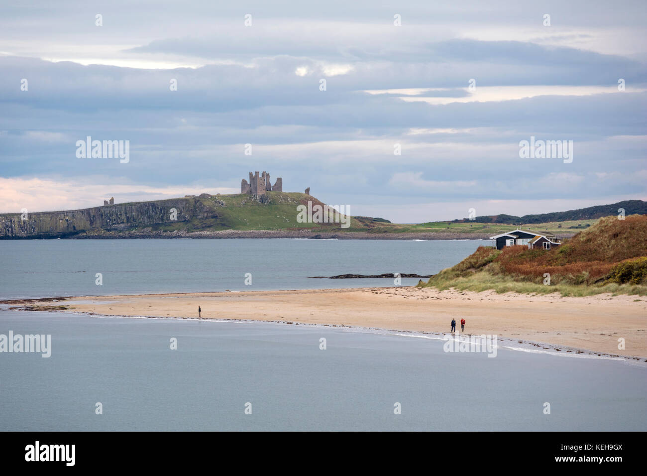 Looking across Embleton Bay towards Dunstanburgh Castle, Northumberland, England, UK - Stock Image