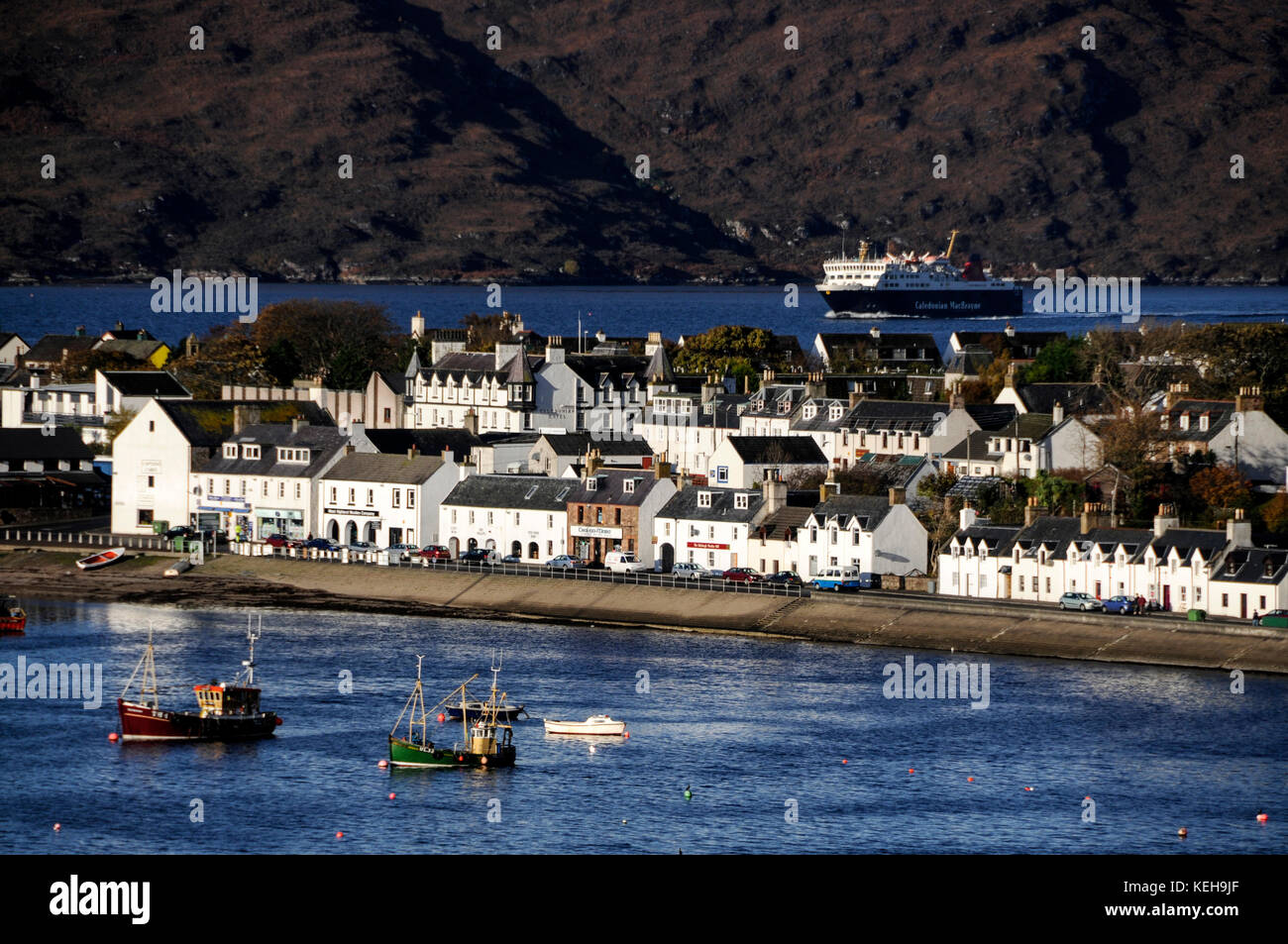 The daily Caledonian MacBrayne car ferry service sails into Ullapool on Loch Broom in northwest Scotland from Stornoway - Stock Image