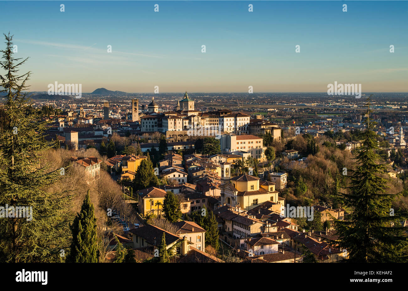 View over Citta Alta or Old Town buildings in the ancient city of Bergamo, Lombardia, Italy on a clear day, taken Stock Photo