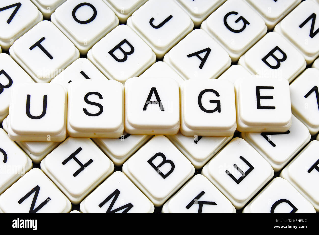 Usage text word crossword. Alphabet letter blocks game texture background. - Stock Image