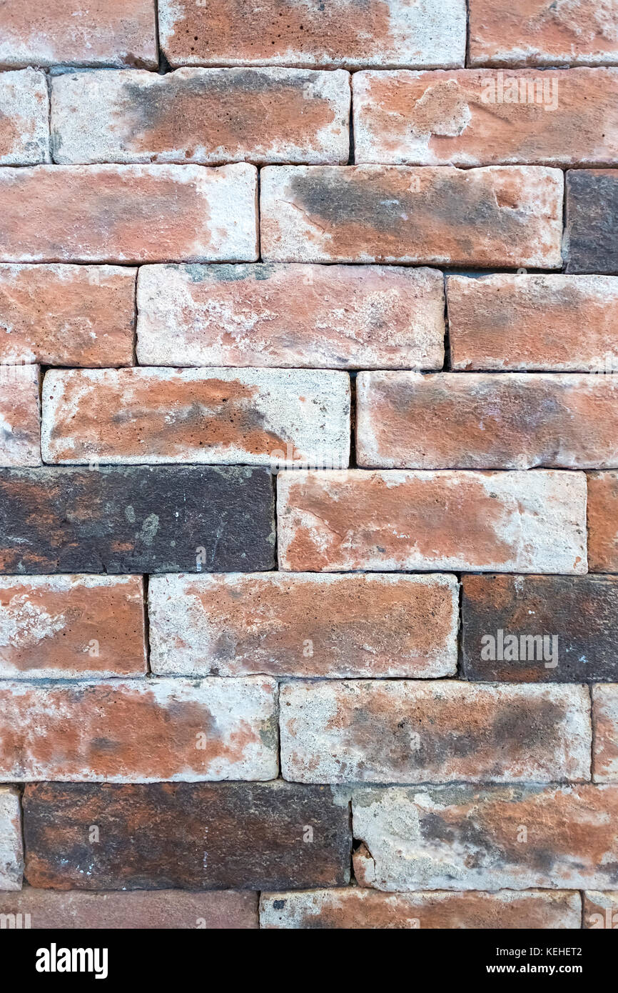 Close-up portrait old brick wall that show texture, detail, can used as graphic resource, wallpaper, background - Stock Image