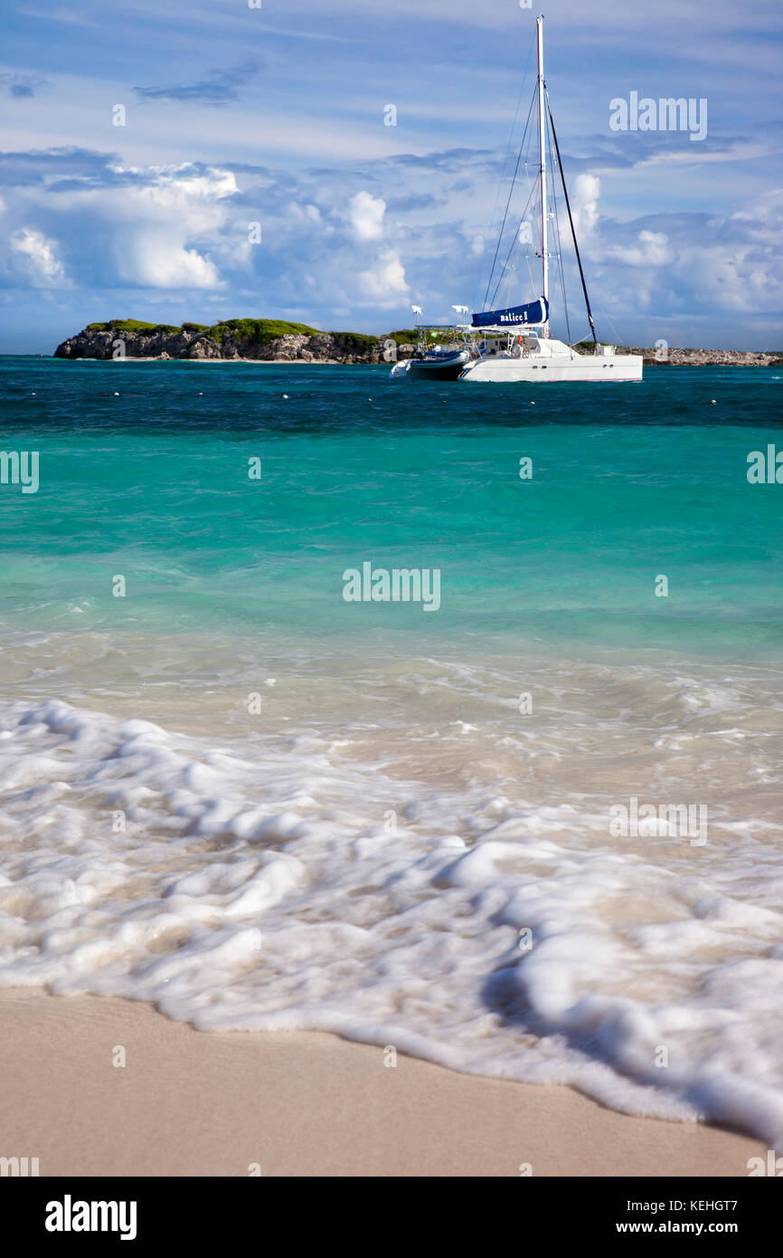 Catamaran moored off Orient Beach on St. Maarten, French West Indies - Stock Image