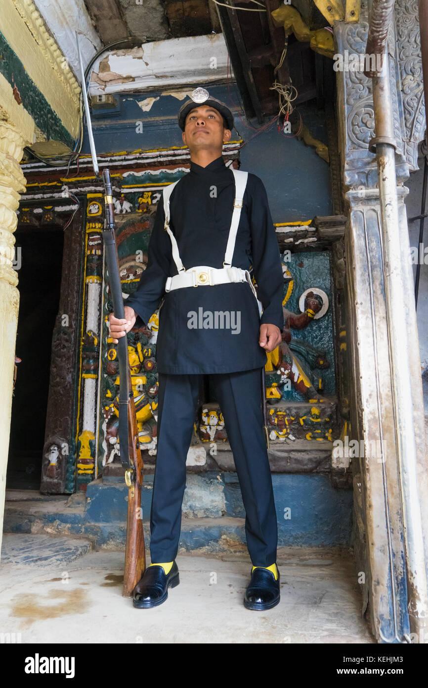 Guard at attention, Royal Palace, Kathmandu, Nepal. - Stock Image
