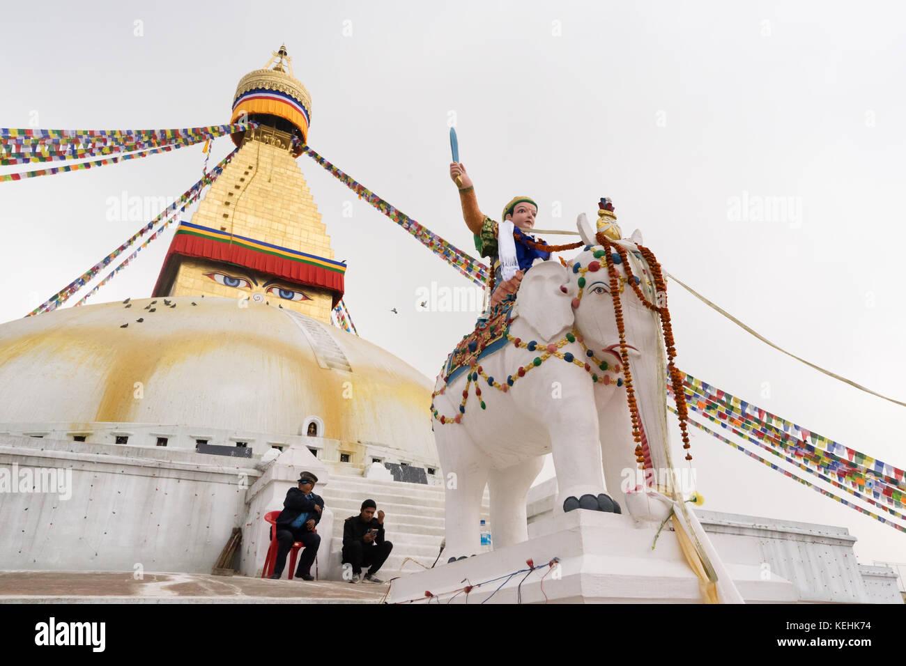 Ornated elephant statue and guards at Bodnath Stupa, Kathmandu, Nepal. - Stock Image