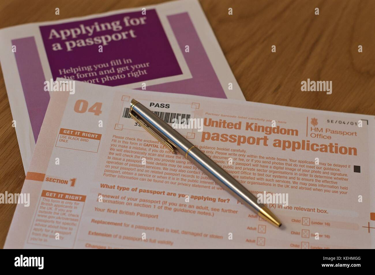 Passport application form stock photos passport application form uk passport application form with instructions and pen ready to fill out stock image falaconquin
