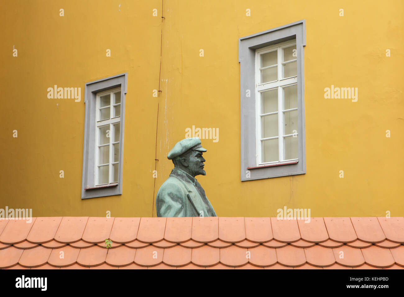 Lenin Monument peeping over the wall in Cheb, Czech Republic. Monument to Russian Bolshevik revolutionary Vladimir Stock Photo