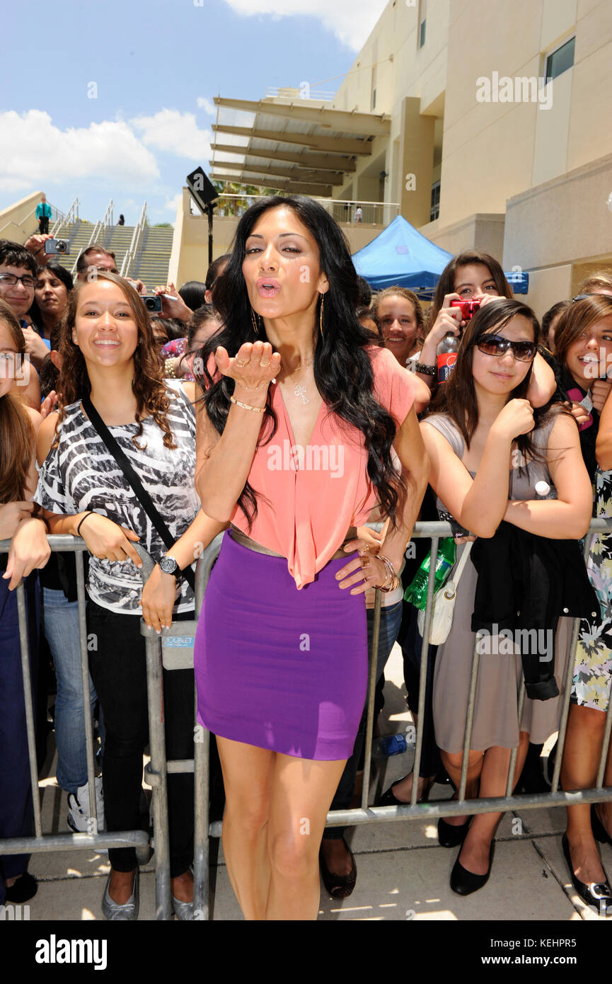 CORAL GABLES, FL - APRIL 14: X Factor judge Nicole Scherzinger arrives at The University of Miami with her body - Stock Image