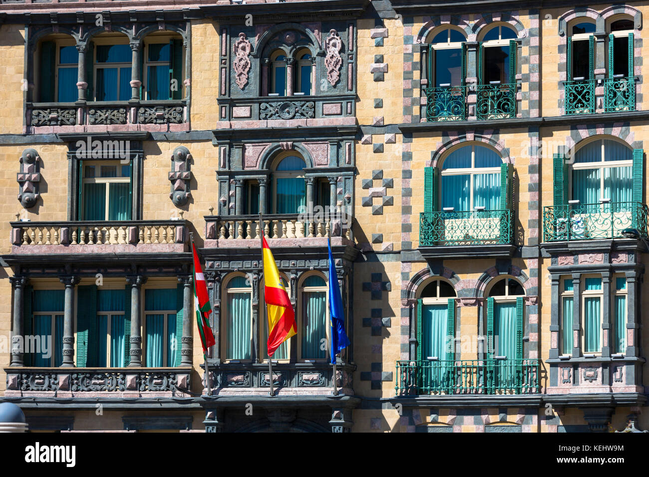 Basque, Spanish and European Union EU flag on Delegation of the Government in Bizkaia at Plaza Moyua in Bilbao, - Stock Image