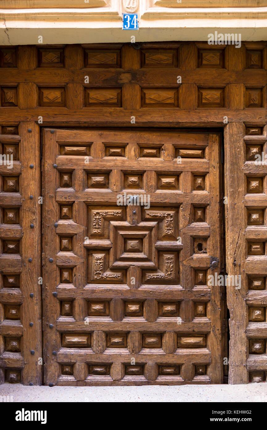 Wooden doorway in Santo Domingo de La Calzada on the Way of St James pilgrim route Camino de Santiago in Castilla - Stock Image