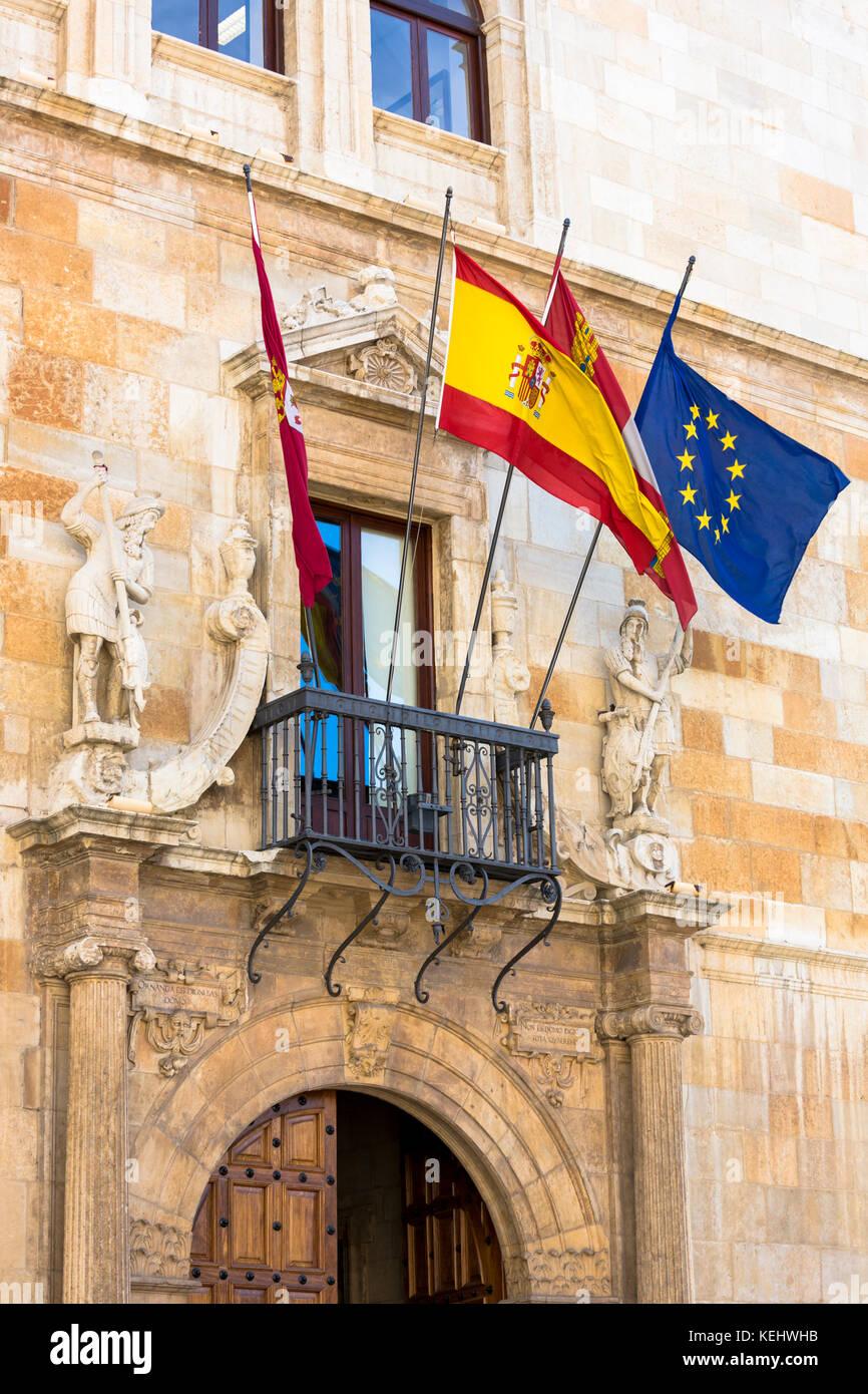 European Union and Spanish flag at 16th Century Palacio de los Guzmanes by Rodrigo Gil de Hontanon in Leon, Castilla - Stock Image