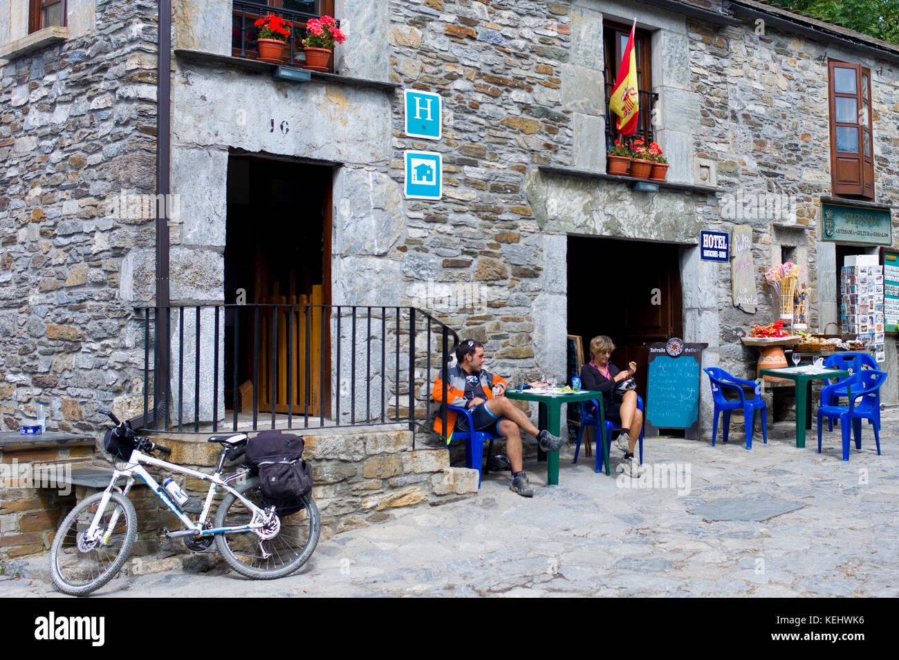 Pilgrims at hotel on the Camiino de Santiago pilgrim route at Triacastela in Galicia, Spain - Stock Image