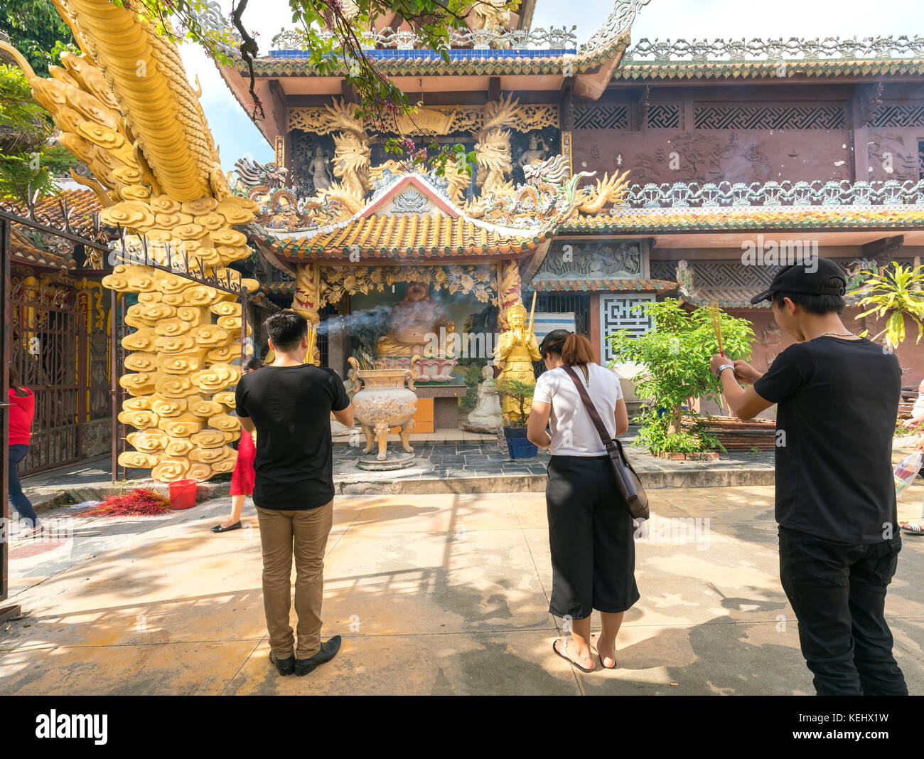Buddhist revered ceremony in temple beautiful architecture, many statues sanctuary express cultural beauty of religious - Stock Image