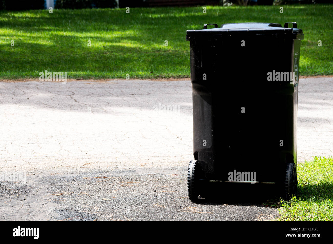 Trash can near the road - Stock Image