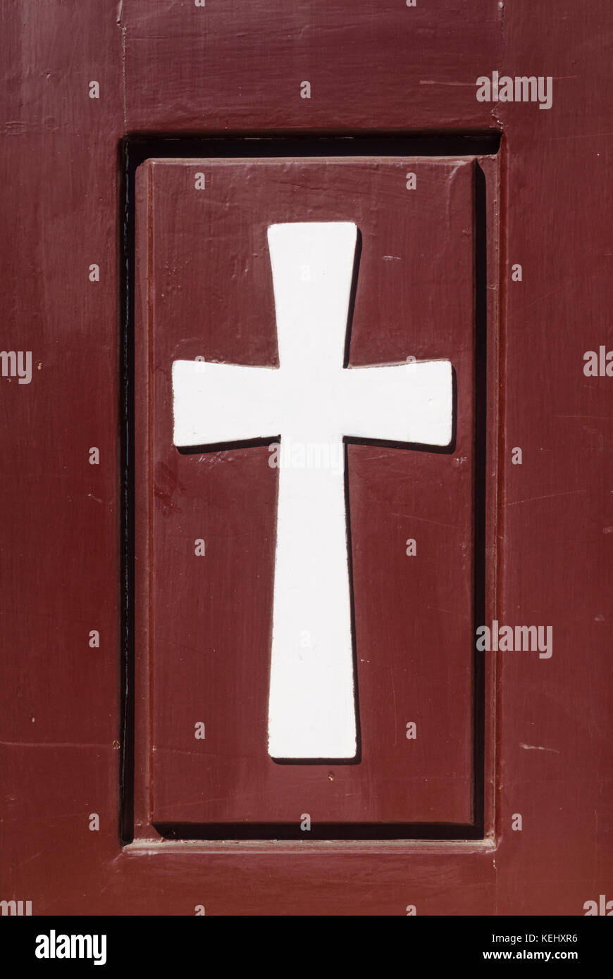 The symbol of Christianity, a Christian Cross on a wooden door in a monastery in Greece - Stock Image