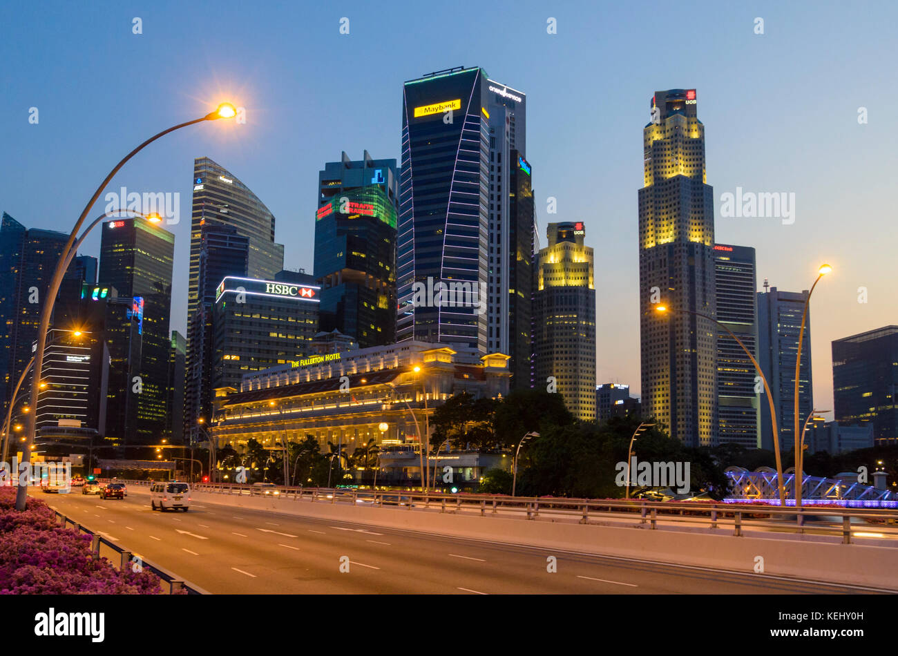 Singapore city sunset over the Jubilee Bridge and the skyscrapers of the downtown CBD, Singapore - Stock Image