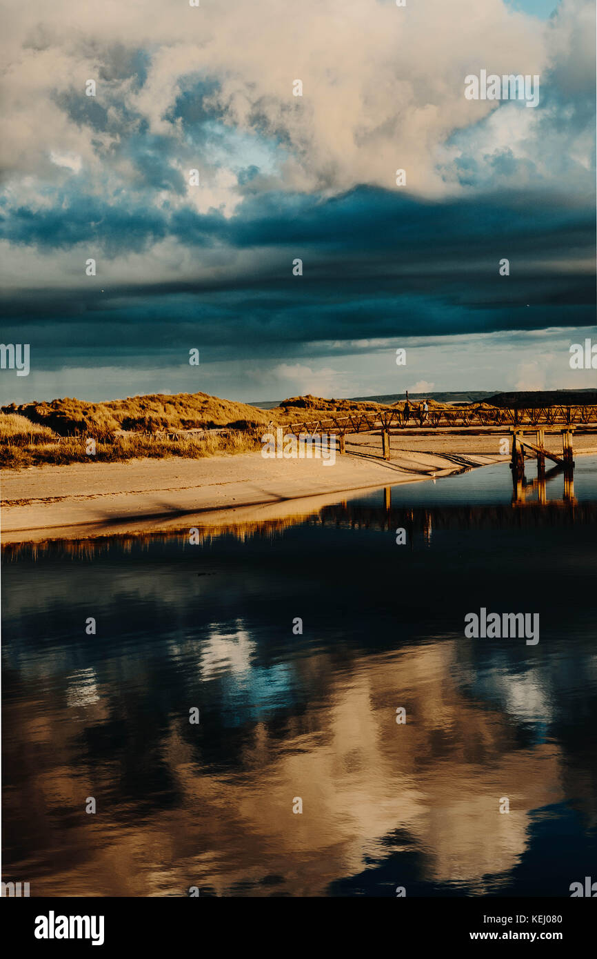 Lossiemouth East Beach and Bridge at Sunset. LOSSIEMOUTH, SCOTLAND - Stock Image