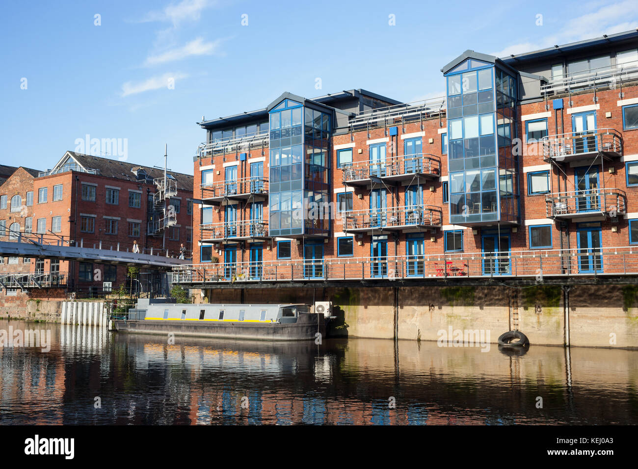 A view of the waterfront along the Leeds-Liverpool Canal in Leeds, England. - Stock Image