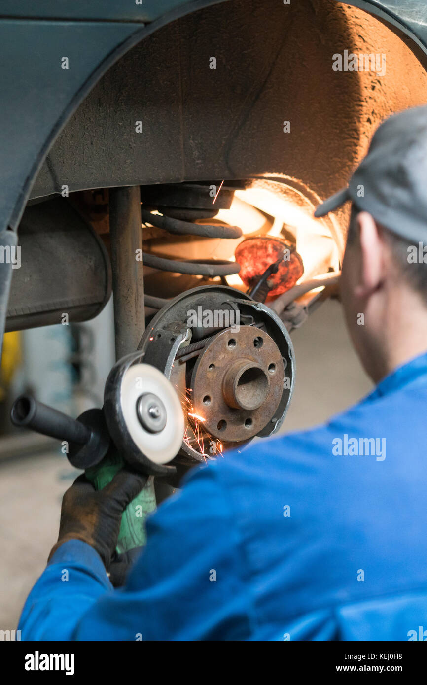 Brake Adjustment Stock Photos Images Alamy All Info About Auto Repair Disc Mechanical Force Diagram Car Mechanic Worker Replacing Brakes Of Lifted Automobile At Garage Shop Station