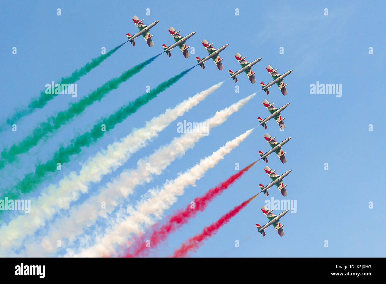 Frecce Tricolori, Italian national air patrol, flying in formation during air show with tricolor smoke Stock Photo