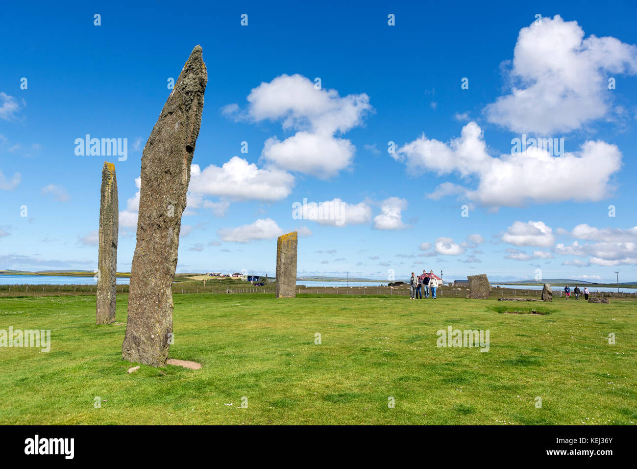 Tourists at the Standing Stones of Stennes, Mainland, Orkney, Scotland, UK. The stones are the remains of a Neolithic - Stock Image