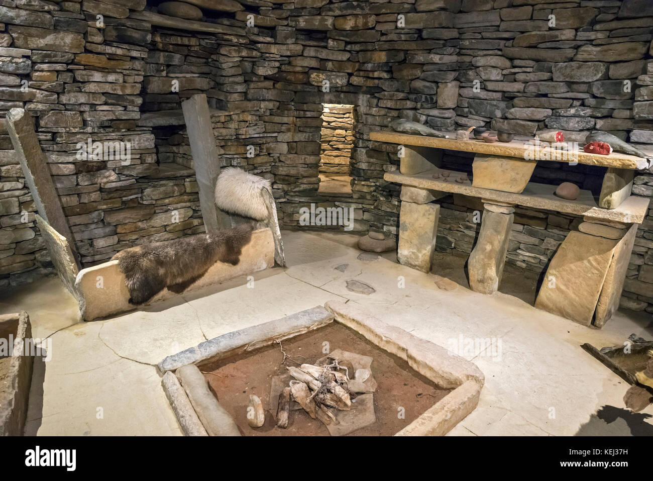 Replica of the interior of a stone house at the Neolithic settlement of Skara Brae, Mainland, Orkney, Scotland, Stock Photo