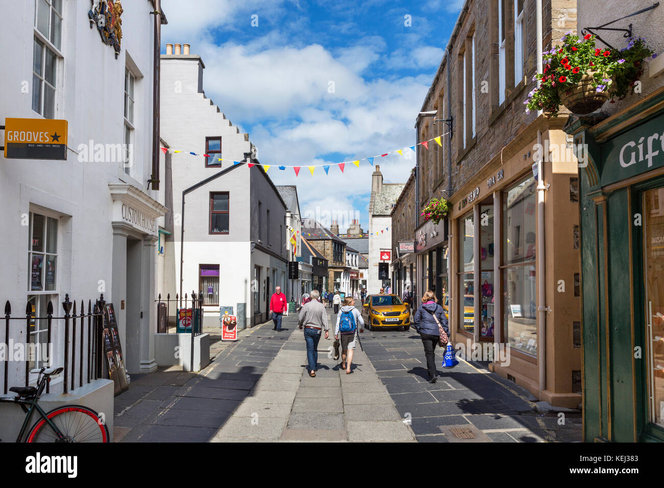 Shops on Albert Street in the town centre, Kirkwall, Mainland, Orkney, Orkney Islands, Scotland, UK - Stock Image
