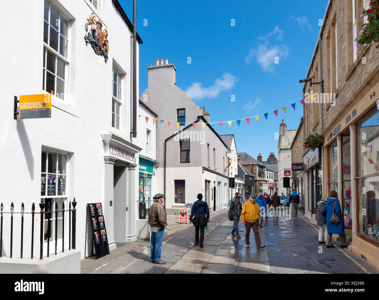 Shops on Albert Street in the town centre, Kirkwall, Mainland, Orkney, Scotland, UK - Stock Image