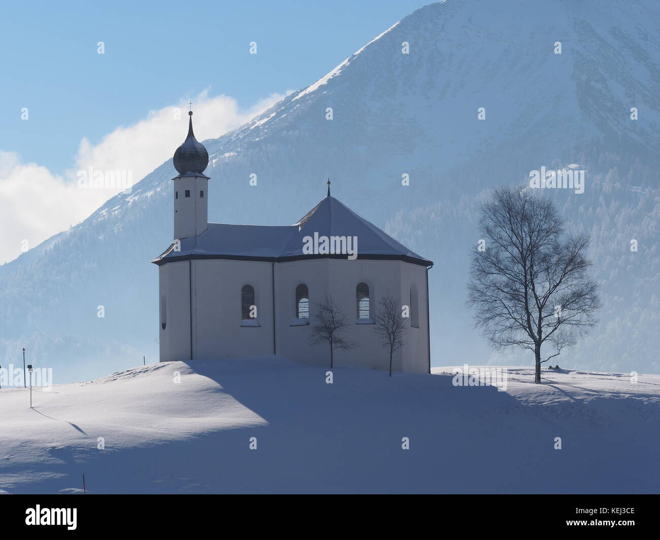 St. Anna chapel on a snowy hill in Austria - Stock Image