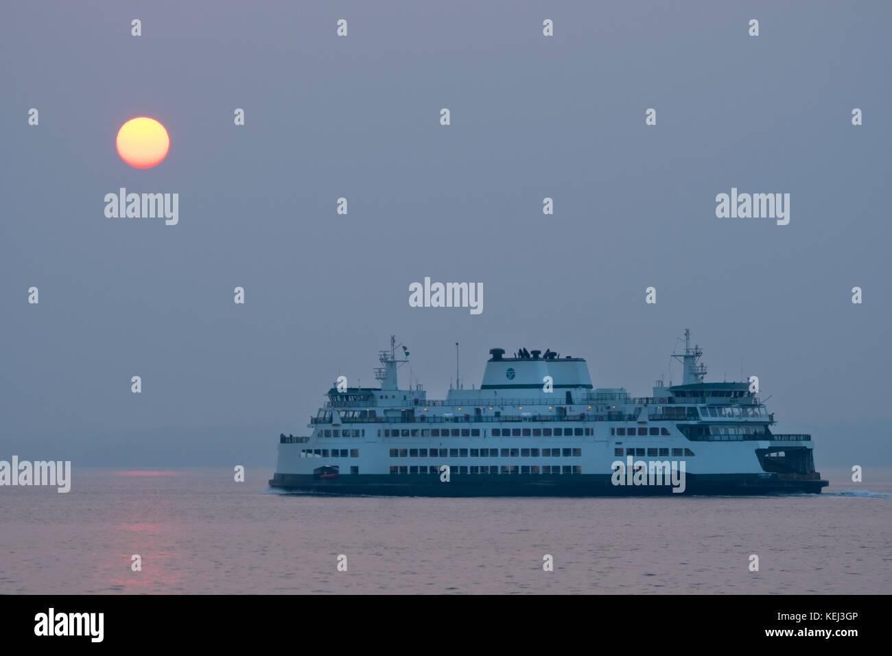 Hazy sunset and Washington State Ferry, Puget Sound, Seattle - Stock Image