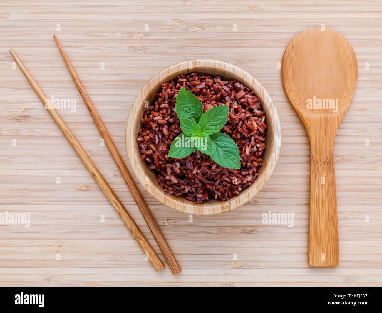 Steamed traditional thai rice in bowl with spoon hight fiber and vitamin E for dietary and healthy food. - Stock Image