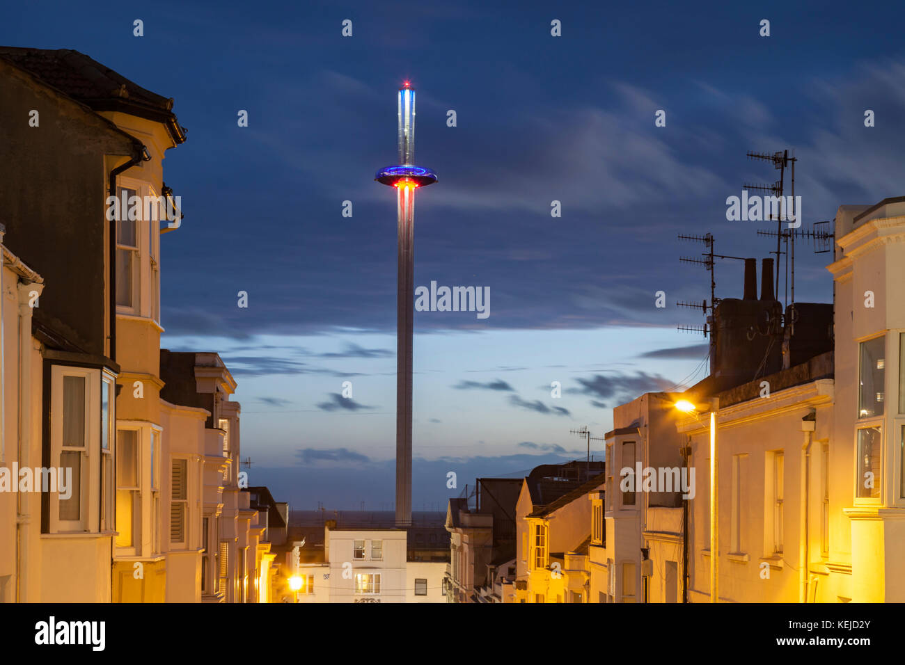 Night falls in Brighton city centre, East Sussex, England. i360 tower in the distance. - Stock Image